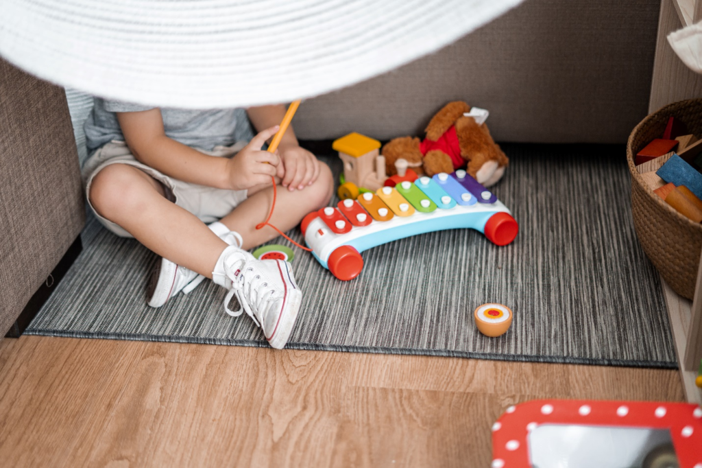 Kid Playing With A Xylophone